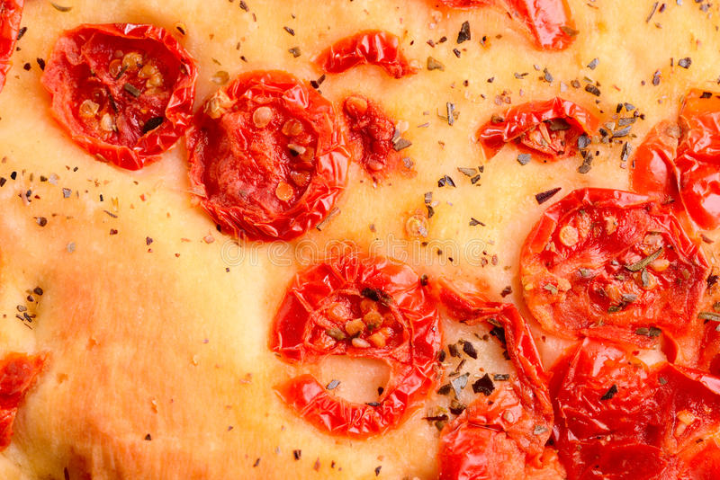 Italian focaccia with little tomatoes stock photography