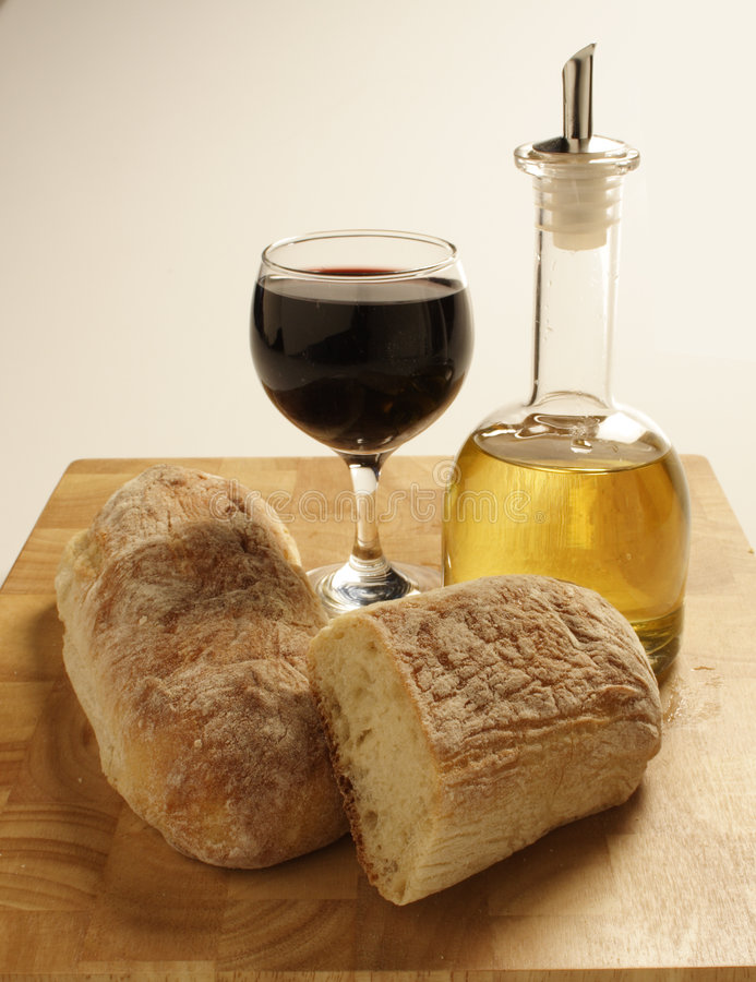 Italian Food. Collection of Italian food: red wine, olive oil and fresh ciabatta bread royalty free stock images