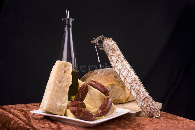 Italian food. Still life of simple Italian food- salami, bread, cheese royalty free stock images