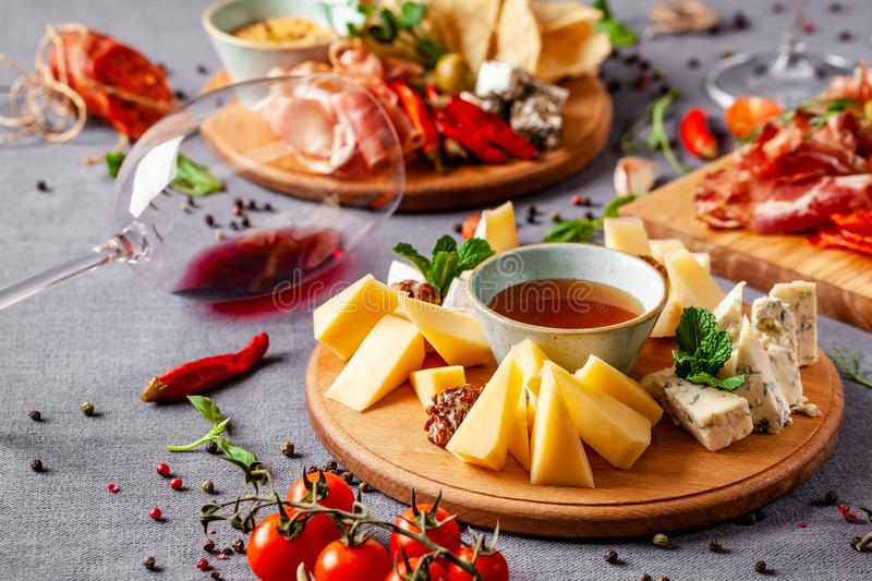Italian food. Assortment of appetizers for a large company in a restaurant. Different types of smoked meat, sausages and cheeses. stock image