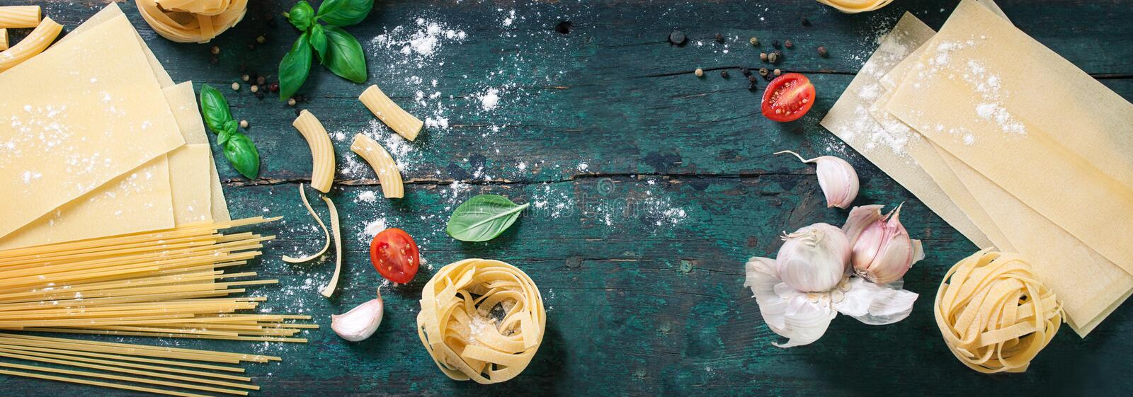 Italian food background with different types of pasta, health or vegetarian concept. Top view with copy space, toned royalty free stock image