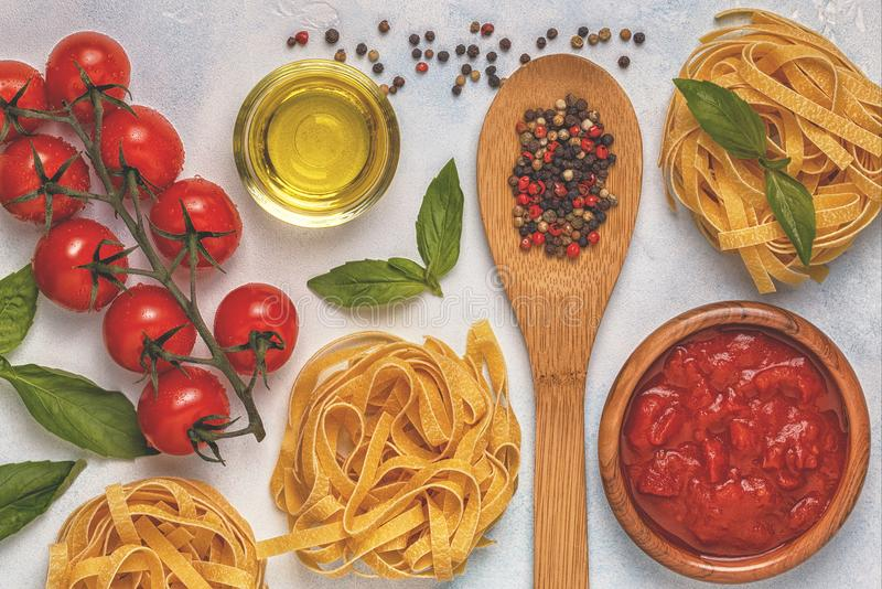 Italian food background with pasta, spices and vegetables. Top view, copy space royalty free stock images