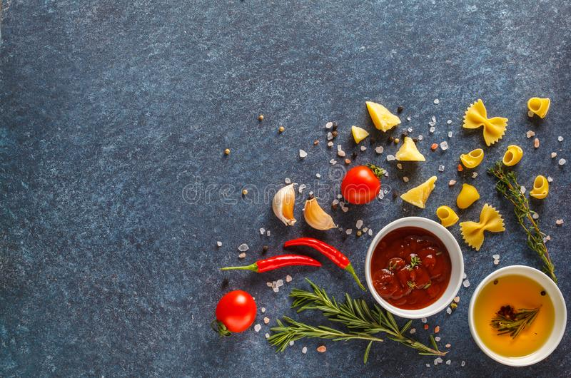 Italian food background with pasta, spices and vegetables. Top v stock image