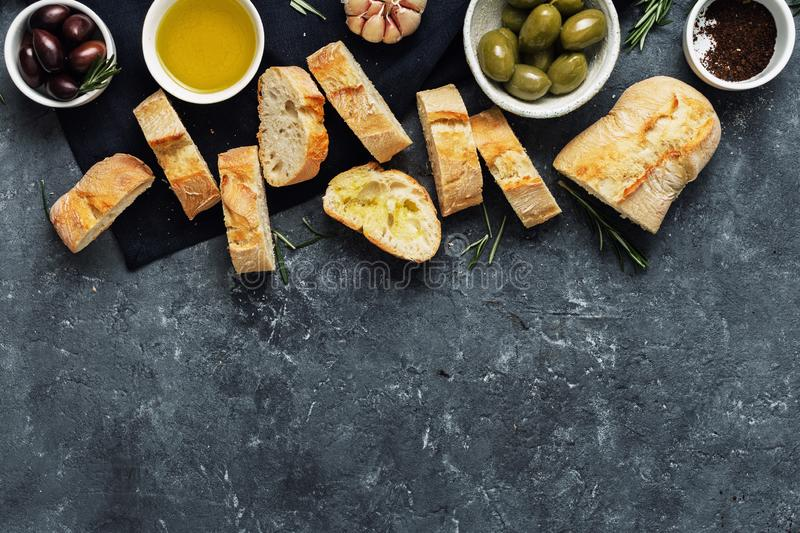 Italian food Cooking Italian bruschetta Olives fresh baguette slices olive oil garlic rosemary royalty free stock photos