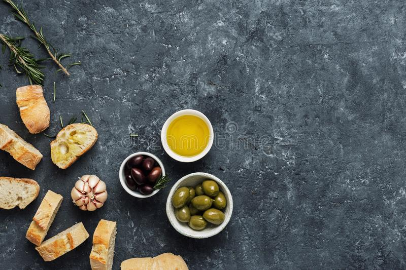 Italian food Cooking Italian bruschetta Olives fresh baguette slices olive oil garlic rosemary stock image