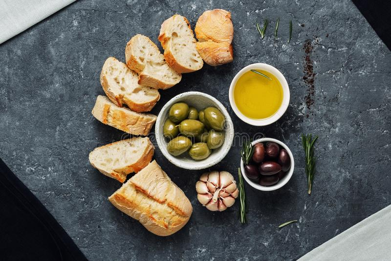 Italian food Cooking Italian bruschetta Olives fresh baguette slices olive oil garlic rosemary royalty free stock photography