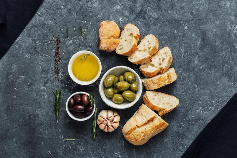 Italian food Cooking Italian bruschetta Olives fresh baguette slices olive oil garlic rosemary royalty free stock image