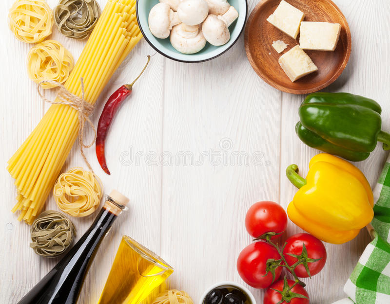Italian food cooking ingredients. Pasta, tomatoes, peppes royalty free stock image