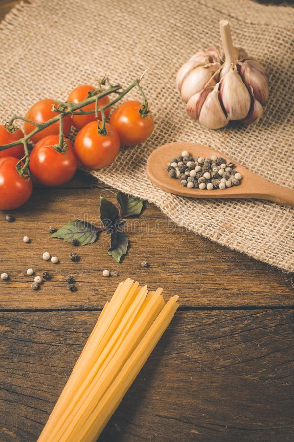 Italian food cooking ingredients. Pasta, vegetables, spices royalty free stock images