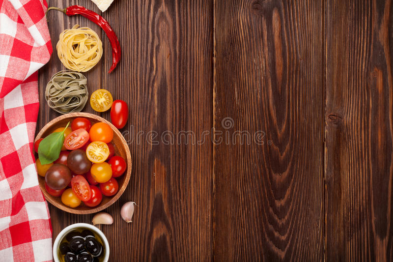 Italian food cooking ingredients. Pasta, vegetables, spices stock photography
