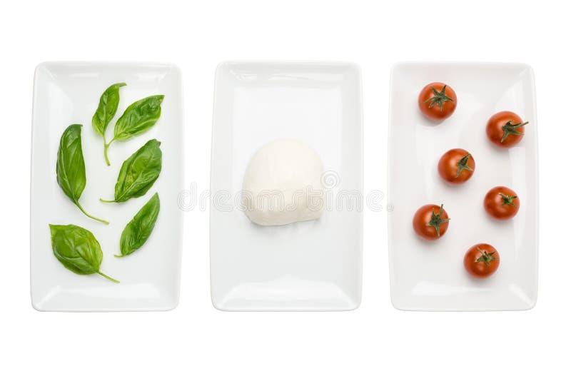 Italian food flag, basil mozzarella tomato white royalty free stock images