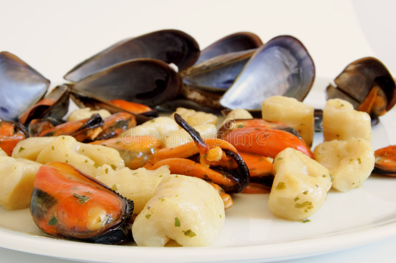Italian food: gnocchi with mussels stock photos