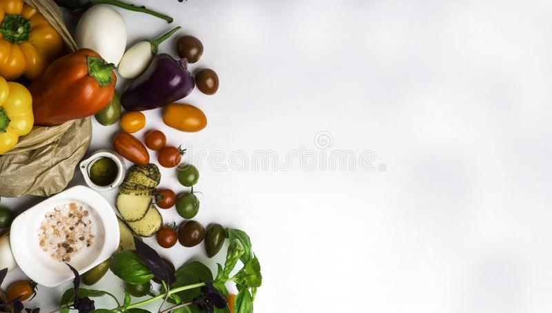Italian food cuisine ingredients background, pasta or pizza on cooking, fresh vegetables, cheese, spices, oil,basil, bell peppers, royalty free stock image