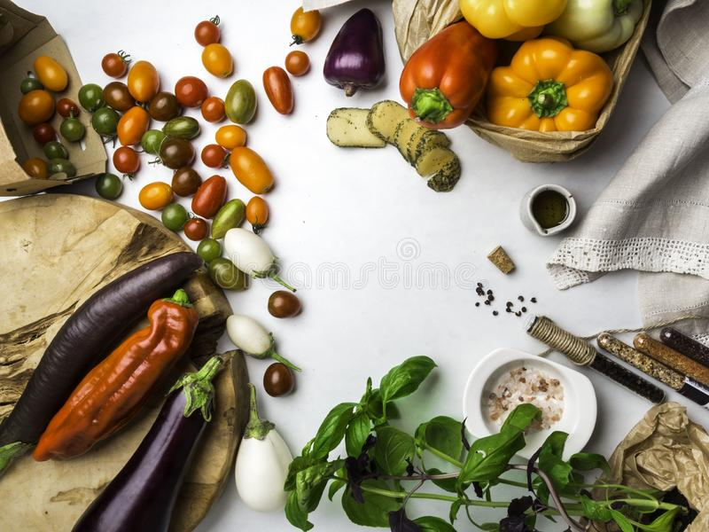 Italian food ingredients background with vegetables, salt, spices and herbs, cheese, olive oil, basil, bell peppers, eggplant and royalty free stock photos