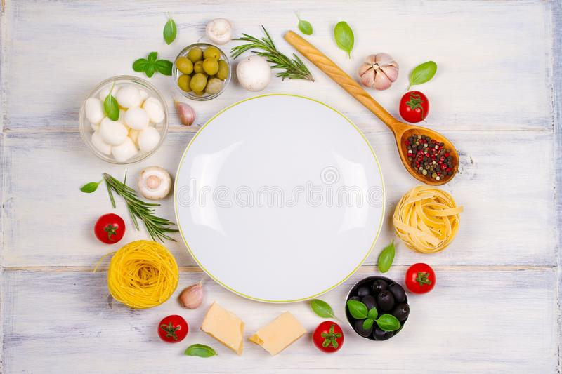 Italian food or ingredients with fresh vegetables, pasta, cheese mozzarella and parmesan, spices stock images