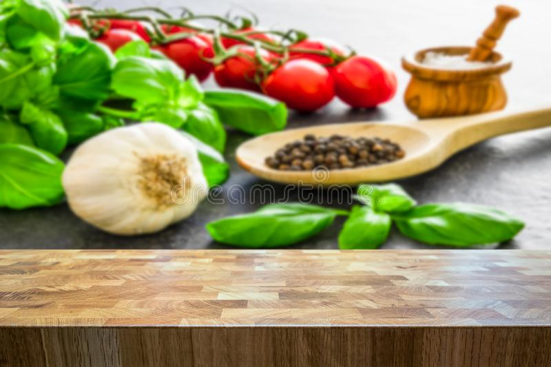 Italian food ingredients. Herbs and seasoning spices blurred in the background stock images