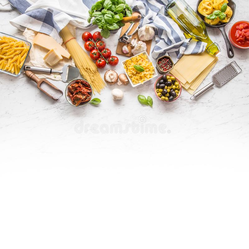 Italian food ingredients pasta olive oil parmesan cheese basil g. Arlic mushrooms tomatoes olives on marble board stock photos