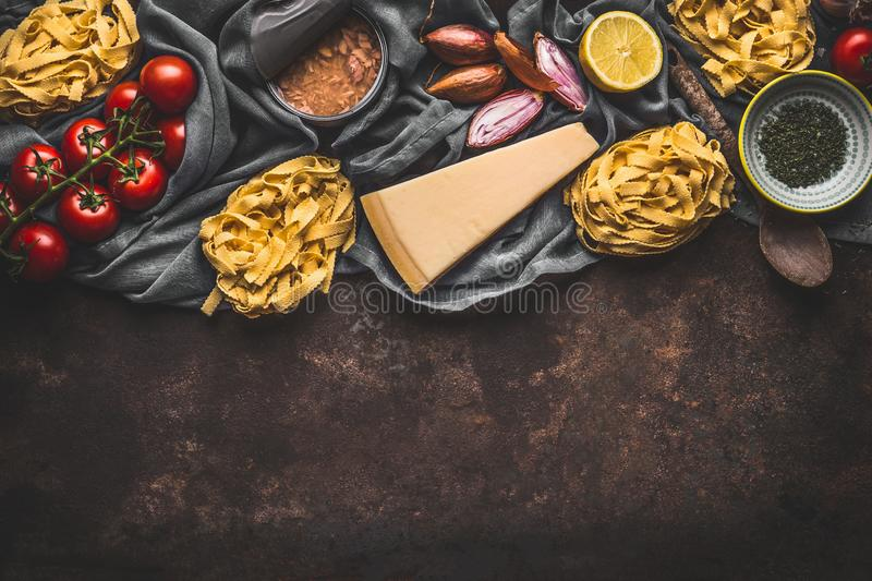 Italian food ingredients for pasta with tuna tomatoes sauce, top view. Copy space. Pasta,parmesan, open tuna can, tomatoes, onion royalty free stock photos