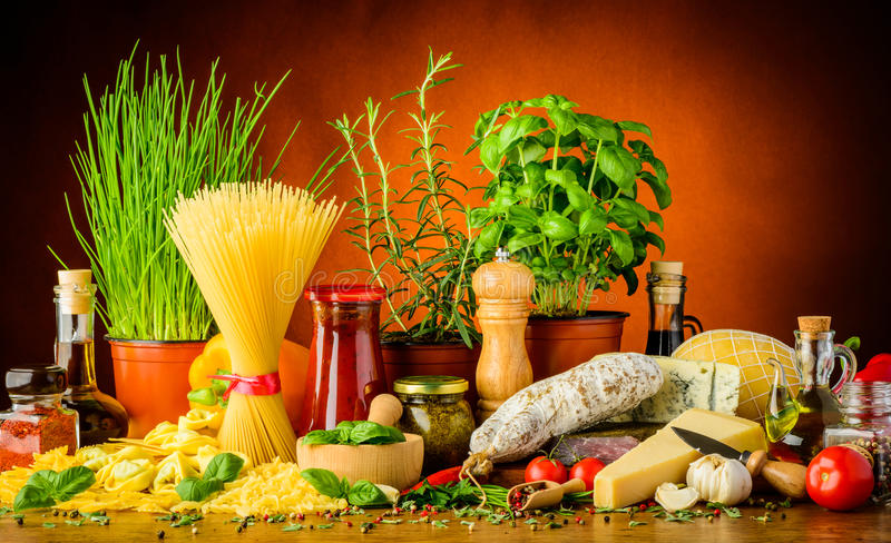 Italian food. Mediterranean and italian food with pasta, cheese, sausages, herbs and spices stock image