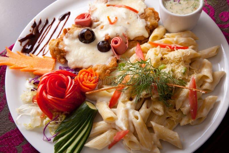 Italian food pasta with chicken Dish stock photos