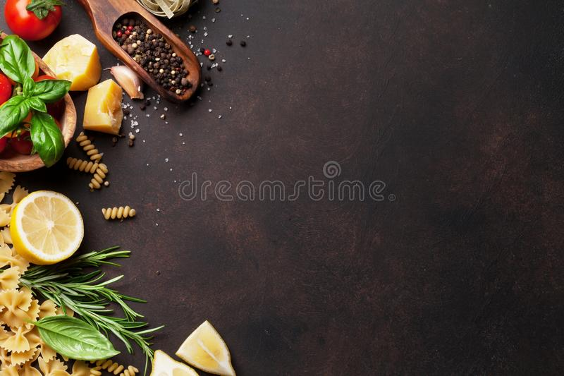 Italian food. Pasta ingredients. On stone table. Top view with space for your text stock images