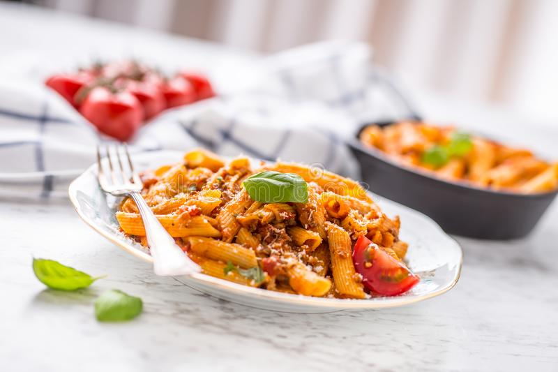 Italian food and pasta pene with bolognese sause on plate royalty free stock photo