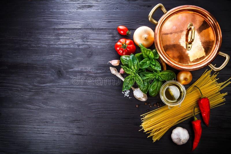 Italian food preparation pasta on wooden board royalty free stock photography