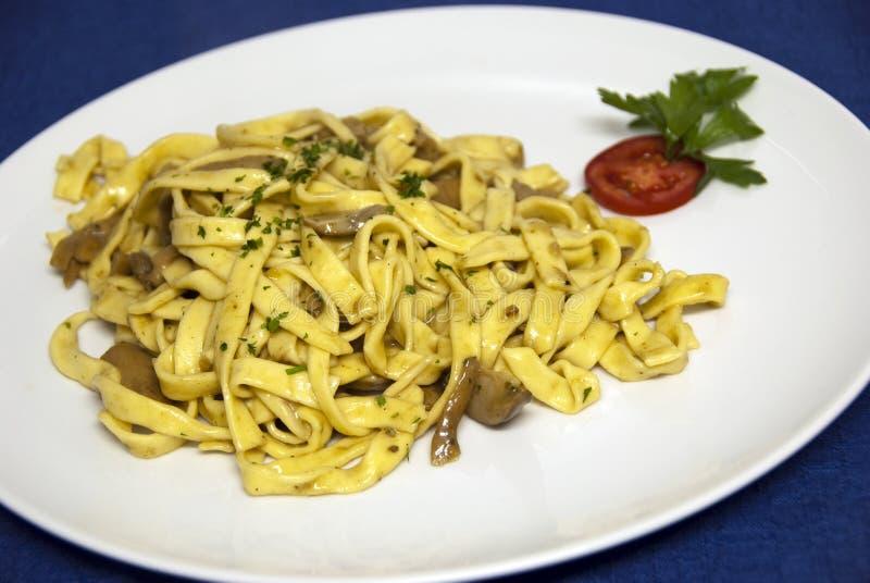 Italian food - tagliatelle with mushroom sauce stock photo