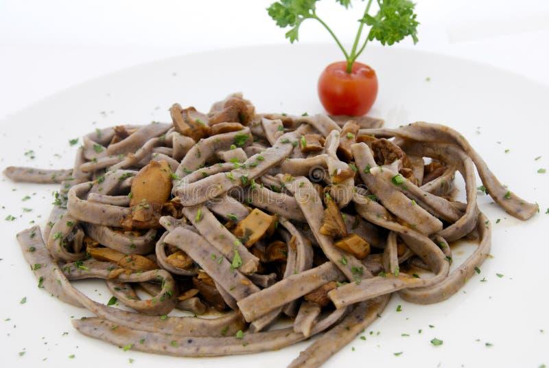 Italian food - tagliatelle with mushroom sauce royalty free stock photography