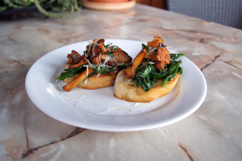 Italian food. On white plate stock image