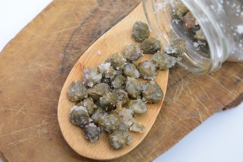 Italian capers from pantelleria on wood spoon. Italian food wood spoon stock images