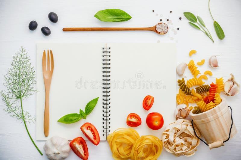 Italian foods concept and foods menu design . Various pasta elbow macaroni ,fusilli ,fettucini with ingredients tomato , sweet ba royalty free stock photo
