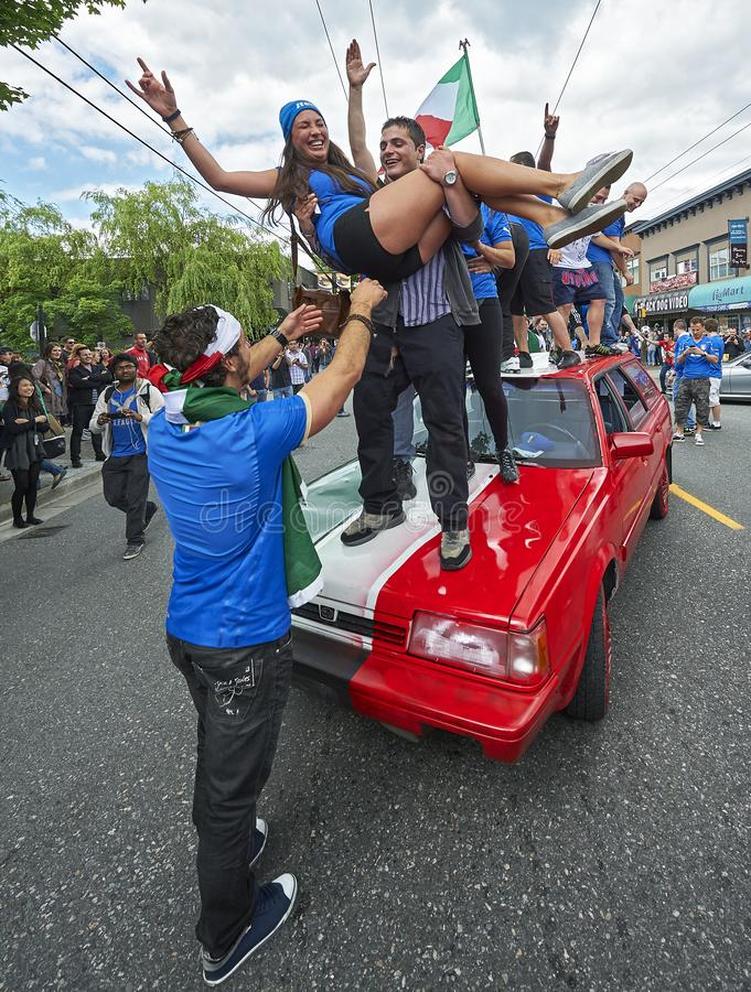Italian football fans celebrating their team`s victory on the streets in Vancouver, Canada royalty free stock photo