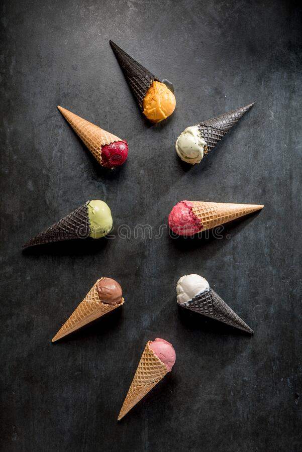 Free Italian Gelato And Sherbet In Waffle Cones On Black Background Royalty Free Stock Photography - 180404427