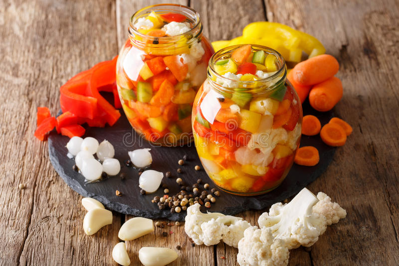 Italian Giardiniera salad of pickled vegetables close-up. horizontal stock photography