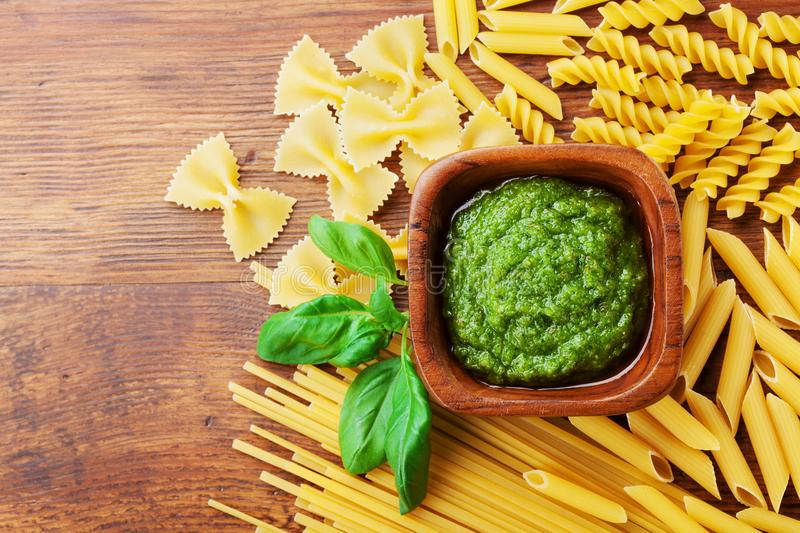 Italian green pesto sauce and collection of pasta top view. Empty space for text. Food concept. royalty free stock images