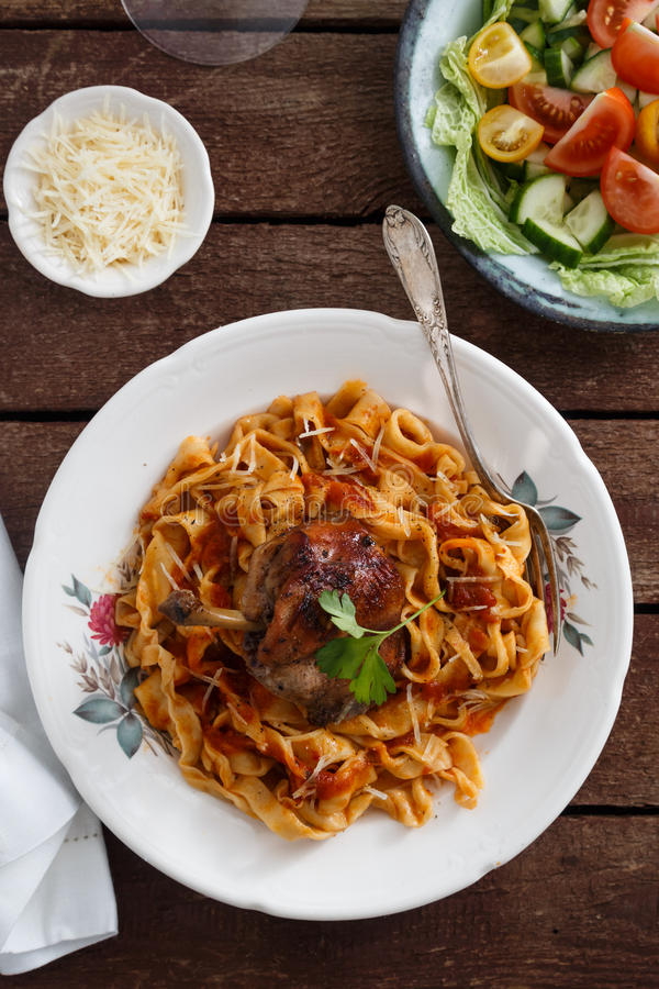 Italian homemade pasta, pappardelle with tomato sauce and braised rabbit, top view close-up.  royalty free stock photo