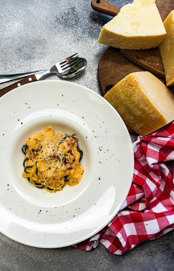 Italian homemade pasta with seafood. Served plate with italian homemade pasta with seafood and cheese on rustic background with copy space royalty free stock photography