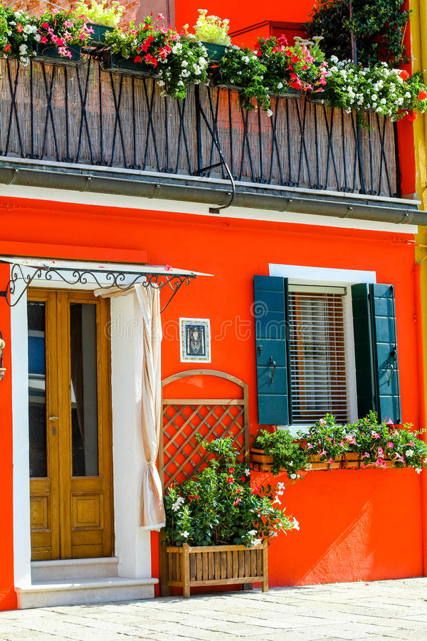 Italian house with orange front. And balcony stock images