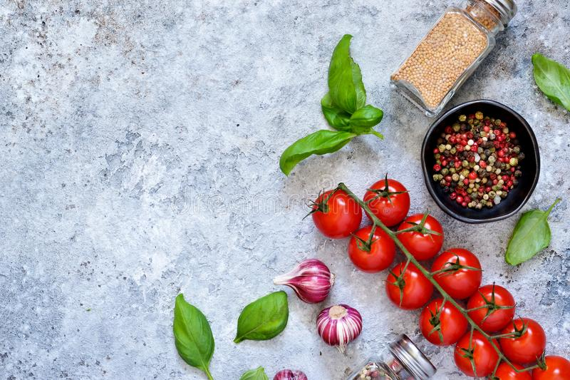 Italian ingredients for cooking. Spices on a concrete background royalty free stock image