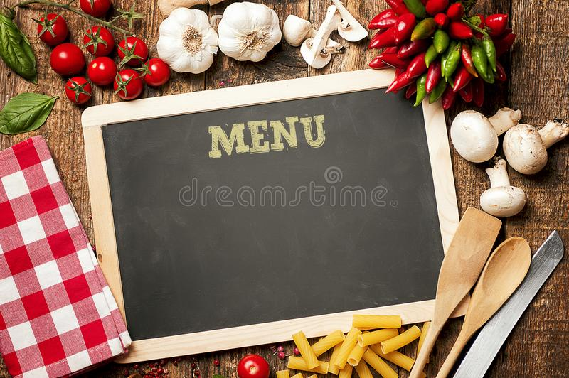 Italian Ingredients for pasta on Chalk Menu Board. Menu of the day concept stock images