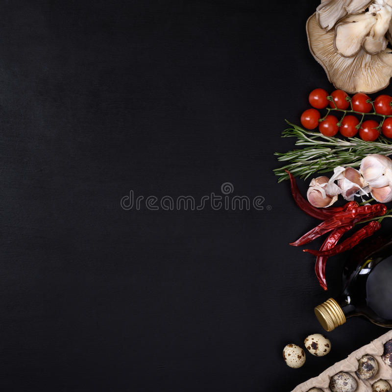 Italian kitchen ingredients on dark background. Vegetarian food, health or cooking concept. Top view and space for text. Fresh vegetable ingredients on dark stock images