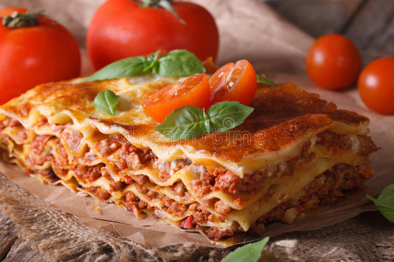 Italian lasagna close-up on the table. horizontal rustic stock photography