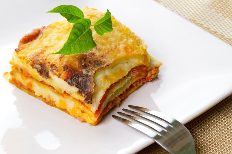 Italian lasagna on plate royalty free stock photo