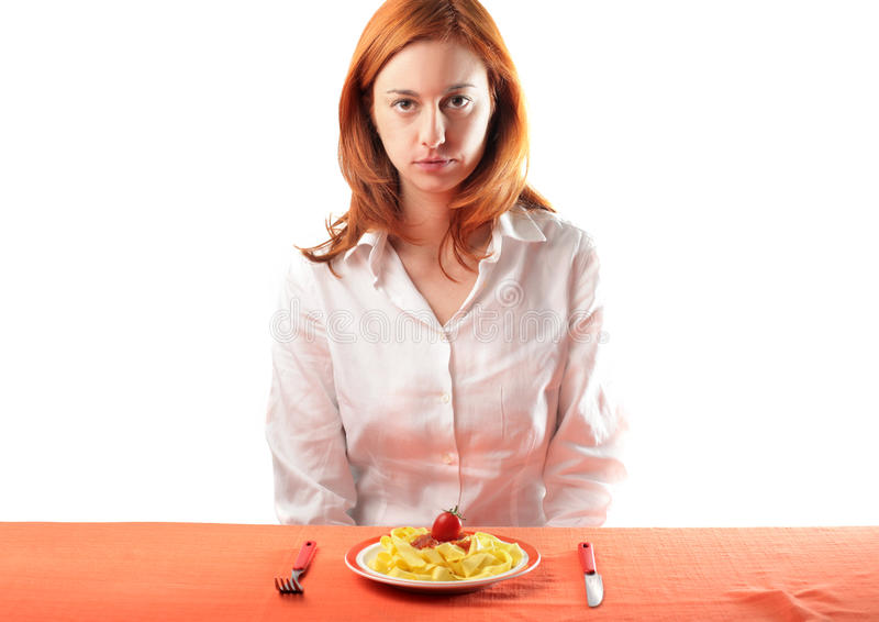 Italian meal. Young woman sitting in front of a plate of tagliatelle stock photo