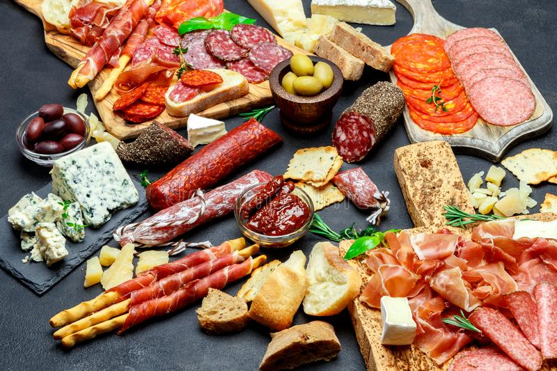 Italian meat appetizer snack set. Salami, prosciutto, bread, olives, capers royalty free stock images