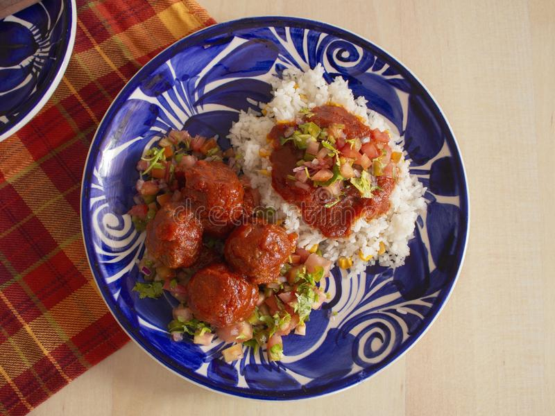 Italian Meatballs with a Local Twist Recipe that includes White Rice Spicy Tomato Sauce and Sliced Tomato Onions and Parsley stock photography
