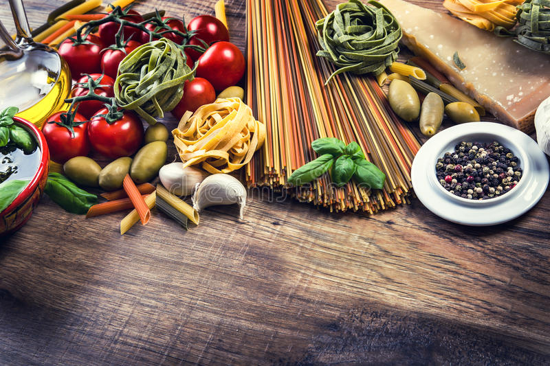 Italian and Mediterranean food ingredients on old wooden background. stock images