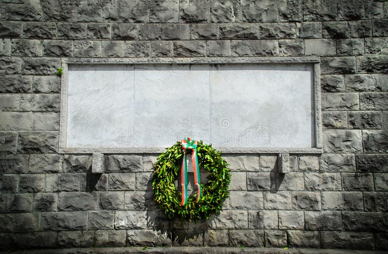 Italian memorial stone blank funeral crown background. Black and white royalty free stock photography