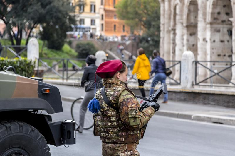 Italian military forces guarding around the ancient structure of the Colosseum in Rome, Italy stock photo